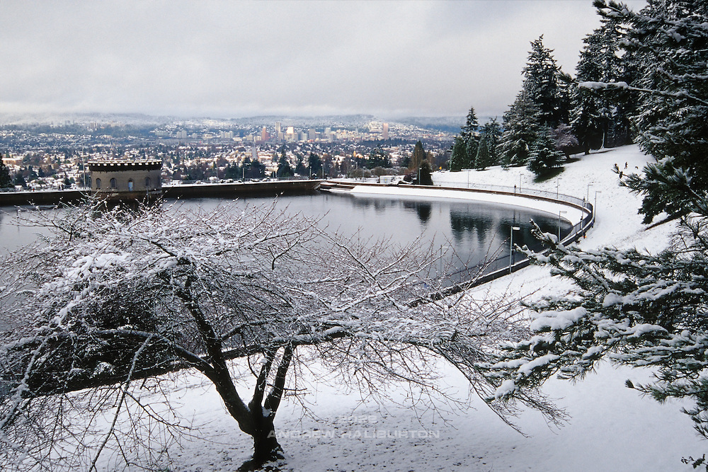Fresh snow blankets Reservoir 5, one of three open reservoirs at Mt Tabor Park and of five total in Portland (background).  The 3 open reservoirs in Mount Tabor Park were placed in the National Register of Historic Places on January 15, 2004.  Environmental Protection Agency (EPA) regulation: Long Term 2 Enhanced Surface Water Treatment Rule, referred to as the LT2 rule imposes new requirements that open water reservoirs be covered, buried or additionally treated.  This applies to Portland's five open reservoirs and to the unfiltered Bull Run source supplying them.  Photo: January 2002.  Nikon F4, 24-85/2.8-4D.  Kodak E100VS