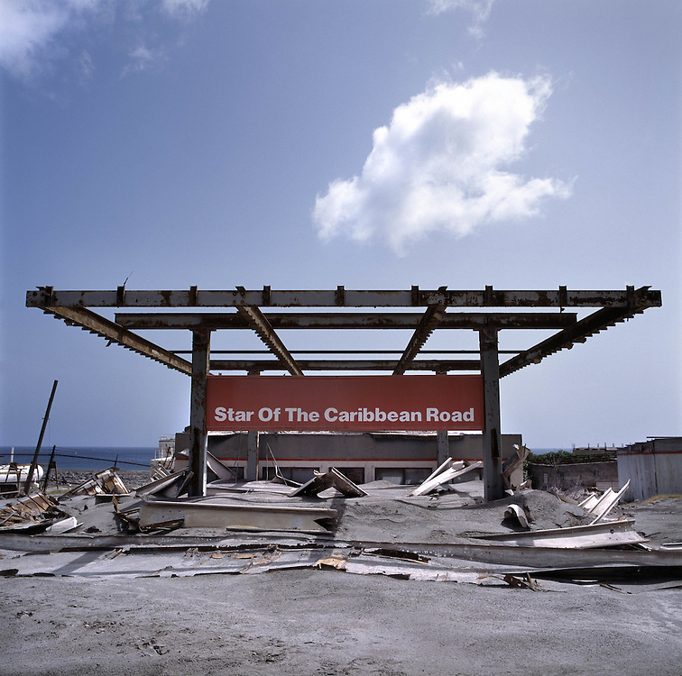 The former capital of Montserrat, Plymouth, which is now covered under a layer of ash, mud and rock from the eruption of the Soufriere Hills volcano over the last 10 years. The area is out of bounds to everyone except scientists. Photo shows Star of The Caribbean petrol station covered in ash and mud..