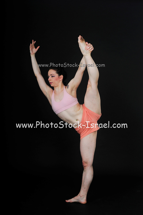 Young female modern dancer On black Background
