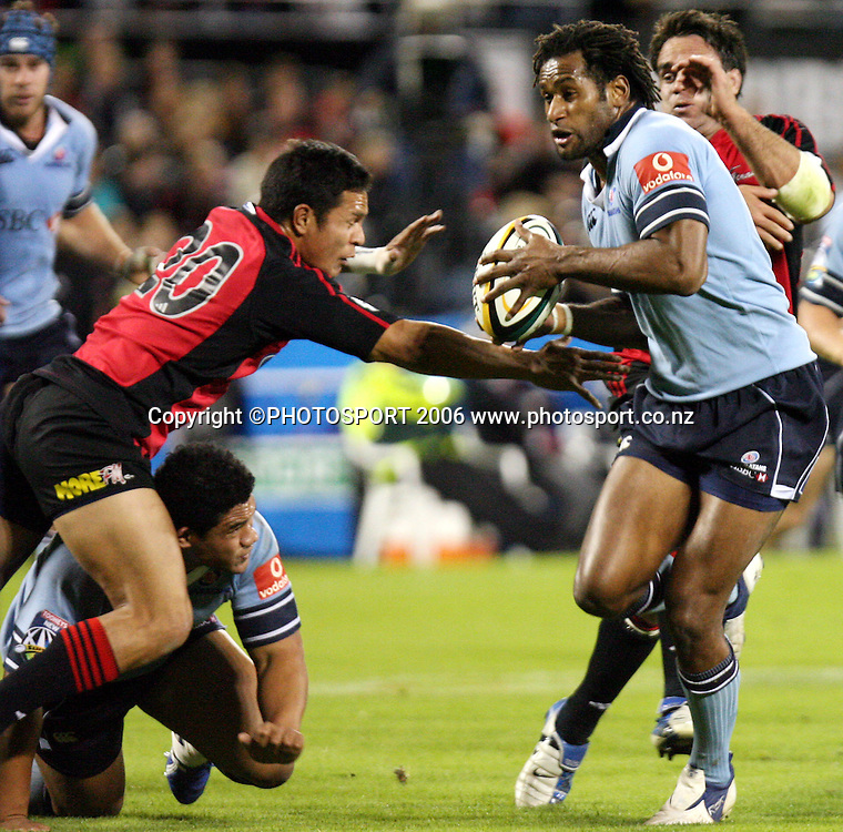 Waratahs winger Lote Tuqiri makes a burst during the Rebel Sport Super 14 rugby game between the Crusaders and the Waratahs at Jade Stadium, Christchurch, New Zealand on Friday 7 April 2006. The Crusaders won the match 17-11. Photo: Tim Hales/PHOTOSPORT