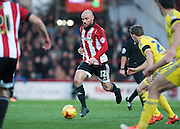 Brentford midfielder Alan McCormack on the ball during the Sky Bet Championship match between Brentford and Nottingham Forest at Griffin Park, London, England on 21 November 2015. Photo by David Charbit.