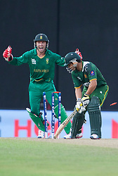 © Licensed to London News Pictures. 28/09/2012. Pakistani batsmen Kamran Akmal is bowled for 1 run  during the T20 Cricket World cup match between South Africa Vs Pakistan at the R.Premadasa Cricket Stadium,Colombo. Photo credit : Asanka Brendon Ratnayake/LNP