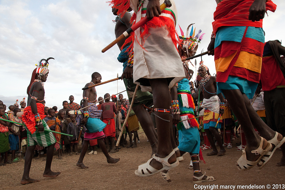 Samburu moran (warriors) jump high as part of the dance, and to show off their skills.  Outside Kisima, Samburu County, Kenya.  August 22, 2013.