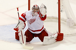 May 8, 2011; San Jose, CA, USA;  Detroit Red Wings goalie Jimmy Howard (35) makes a glove save against the San Jose Sharks during the first period of game five of the western conference semifinals of the 2011 Stanley Cup playoffs at HP Pavilion. Mandatory Credit: Jason O. Watson / US PRESSWIRE