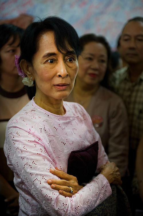 Pro-democracy leader Aung San Suu Kyi chats with supporters at the National League of Democracy (NLD) headquarters,  Yangon (Rangoon) Myanmar (Burma) January 2012