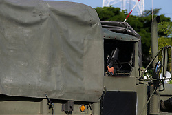© Licensed to London News Pictures. 22/05/2014. An armed military officer inside an army truck blocking the entrance to the army club during a meeting hosted by Thailand's army chief at the Army Club, between representatives from both sides of the country's political groups the PDRC & UDD at the conclusion of the meeting the Thailand army imposed a Military Coup, in Bangkok Thailand.  Photo credit : Asanka Brendon Ratnayake/LNP