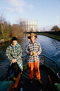 Phil and Symond on canal by gasworks. UK, 1980s.