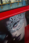 The seductive face and eye of an ad on the side of a London bus, on 15th February 2017, in London borough of Lambeth, United Kingdom.