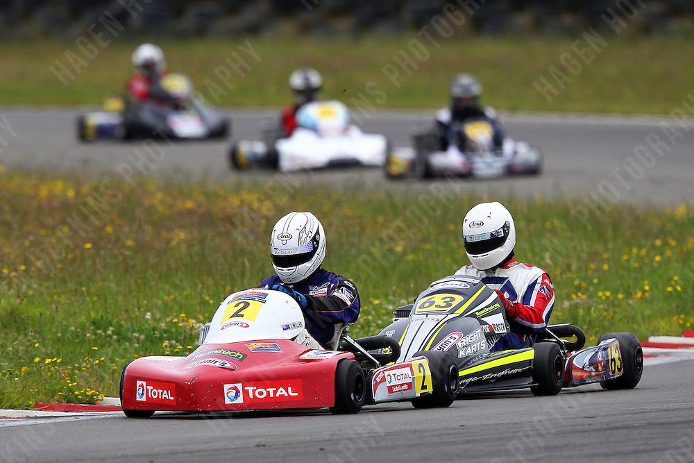 Mason Armstrong, 63, and Lochlan Miller, 2, race in the Rotax Light class during the 2012 Superkart National Champs and Grand Prix at Manfeild in Feilding, New Zealand on Saturday, 7 January 2011. Credit: Hagen Hopkins.