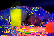 Mad scientist collapses when experiment goes wrong.Black light
