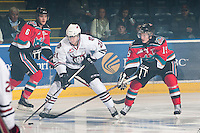 KELOWNA, CANADA - NOVEMBER 9:  Wyatt Johnson #21 of the Red Deer Rebels is checked by Colton Sissons #15 and Mitchell Wheaton #6 of the Kelowna Rockets as the Red Deer Rebels visit the Kelowna Rockets on November 9, 2012 at Prospera Place in Kelowna, British Columbia, Canada (Photo by Marissa Baecker/Shoot the Breeze) *** Local Caption ***