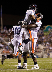 "Virginia wide receiver Andrew Pearman (21) celebrates after scoring a touchdown.  The Virginia Cavaliers football team defeated Middle Tennessee State Blue Raiders 23-21 at Johnny ""Red"" Floyd Stadium  in Murfreesboro, TN on October 6, 2007."