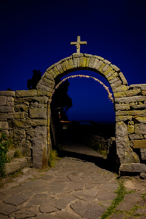 PUNO, PERU - CIRCA OCTOBER 2015:  Arch of the Island of Taquile at night in Lake Titicaca.
