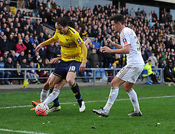 Danny Hylton of Oxford United runs down time in the corner of the pitch in added time. - Mandatory byline: Alex James/JMP - 10/01/2016 - FOOTBALL - Kassam Stadium - Oxford, England - Oxford United v Swansea City - FA Cup Third Round