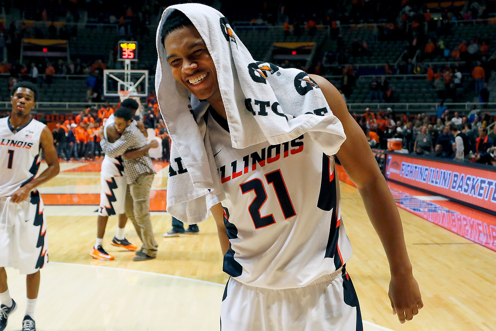 Illinois guard Malcolm Hill (21) smiles as he walks off the court after an NCAA college basketball game at the State Farm Center Friday, Nov. 7, 2014, on the University of Illinois campus in Champaign, Ill. Illinois won the exhibition game 91-62. (Lee News Service/ Stephen Haas)