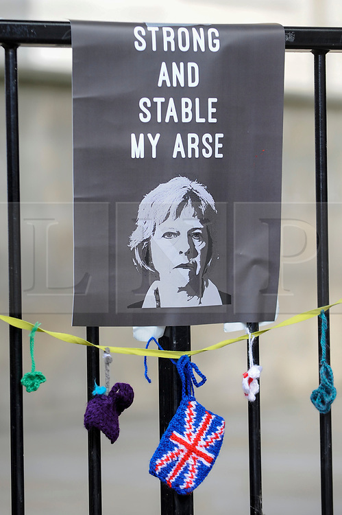 © Licensed to London News Pictures. 09/06/2017. London, UK. A poster hung on a fence re-interprets the Tory manifesto slogan.  Anti-Tory protesters demonstrate outside Downing Street on the day that the General Election results produced a hung Parliament.  A variety of different groups, from LGBT supporters to Save the NHS supporters, gathered to make their views heard. Photo credit : Stephen Chung/LNP