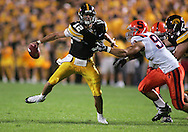 08 SEPTEMBER 2007: Iowa quarterback Ricky Stanzi (12) tries to pull away from Syracuse defensive lineman Oliver Haney (92) in Iowa's 35-0 win over Syracuse at Kinnick Stadium in Iowa City, Iowa on September 8, 2007.