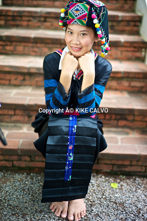 Teen girl wearing a Hmong Lai traditional dress.