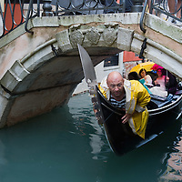 VENICE, ITALY - JUNE 07:  A gondolier tries to negotiate the passage of his gondola under a bridge made difficult due to the out of season very high tide on June 7, 2011 in Venice, Italy. Thunderstorms and heavy rain have hit Venice causing an out season high tide of 90 cm flooding St Mark's square.