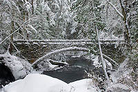 Stone bridge over Whatcom Creek after fresh snowfall, Bellingham Washington USA
