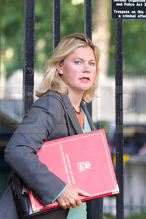 "© Licensed to London News Pictures. 29/08/2013. London, UK. International Development Secretary Justine Greening arrives for a meeting of the British cabinet on Downing Street in London today (29/08/2013) as a recalled British Parliament prepares to debate the possibility of ""direct"" military action over recent reports an alleged chemical weapons attack in Syria. Photo credit: Matt Cetti-Roberts/LNP"