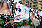 In Cairo's Tahrir Square, people pause to look at the faces of some of the more than 300 individuals who had been killed during the previous two weeks of anti-government protest. Two days after this photo was taken, Egyptian president Hosni Mubarak would resign from office. (Cairo, Egypt - February 9, 2011)