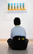"""A boy from Charlton Manor Primary School admires Patrick Hughes' """"Shutters"""", a hand painted with lithography piece created in 2003, at the preview for the It's Our World charity auction at Christie's, Mayfair, London.<br /> Picture by Paul Davey/Focus Images Ltd +447966 016296<br /> 04/03/2016"""