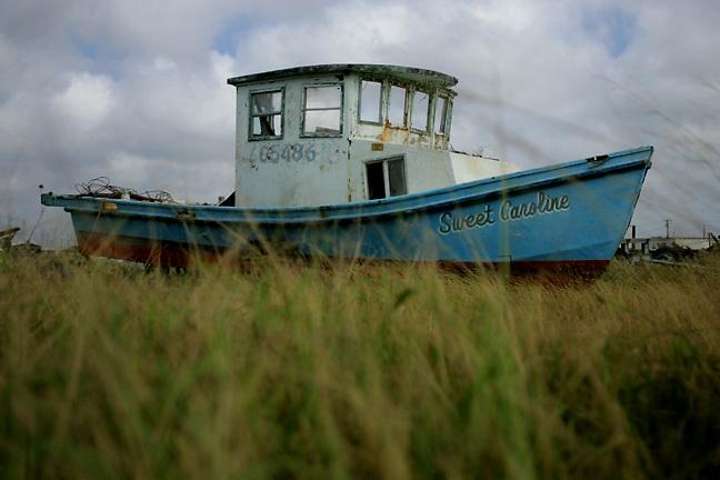 An abandoned fishing boat in a boat yard in Port Aransas, Texas.