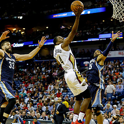 Mar 21, 2017; New Orleans, LA, USA; New Orleans Pelicans guard Jordan Crawford (4) shoots over Memphis Grizzlies guard Andrew Harrison (5) and center Marc Gasol (33) during the second half of a game at the Smoothie King Center. The Pelicans defeated the Grizzlies 95-82. Mandatory Credit: Derick E. Hingle-USA TODAY Sports