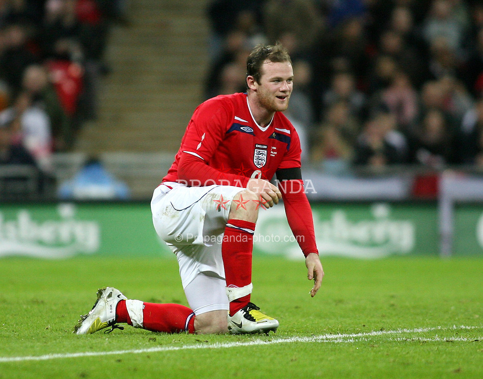 LONDON, ENGLAND - Monday, January 21, 2008: England's Wayne Rooney in action against Switzerland during an international friendly match at Wembley Stadium. (Photo by Chris Ratcliffe/Propaganda)