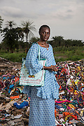 Isatou Ceesay stands at a waste dump in the town of Birkama. Mrs Ceesay founded the Women's Initiative Gambia in 1997. The organisation works with communities across the tiny west African state to address not only the environmental impact of unregulated waste disposal, particularly plastic, but also the empowerment of women in the make dominated society. Over one hundred women are now involved in Isatou's project.
