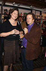 MARCELLA EDWARDS and writer MARK McCRUM biographer of singer Robbie Williams at a party to celebrate the publicarion of The Meaning of Tingo by Adam Jacot de Boinod held at the Daunt Bookshop, 83 Marylebone High Street, London on 18th October 2005.<br />