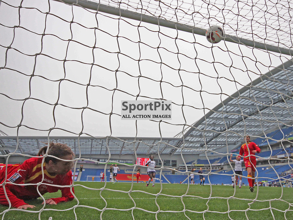 England score and Montenegro's Tatjana Djurkovic looks on during the FIFA Women's World Cup qualifier match between England and Montenegro at the American Express Community Stadium, Brighton, 5th April 2014 © Phil Duncan | SportPix.org.uk