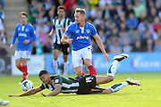 Plymouth Argyle's Jake Jervis is brought down by Portsmouth's Adam McGurk during the Sky Bet League 2 play off first leg match between Plymouth Argyle and Portsmouth at Home Park, Plymouth, England on 15 May 2016. Photo by Graham Hunt.