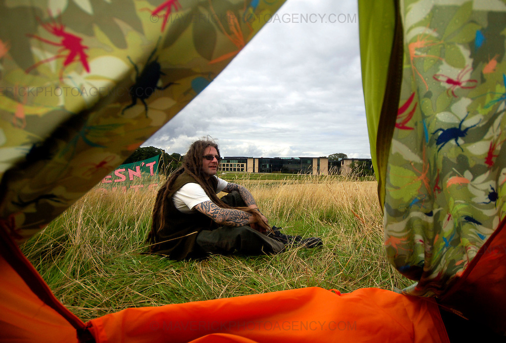 EDINBURGH, UK - 19th August 2010: Climate change protesters have set up camp close to the Royal Bank of Scotland headquarters in Edinburgh...The Camp for Climate Action is protesting about RBS's role in financing oil industry developments...Picture shows 'Ziggy' after pitching his tent with RBS HQ at Gogarburn in the background...(Photograph: Richard Scott/MAVERICK)