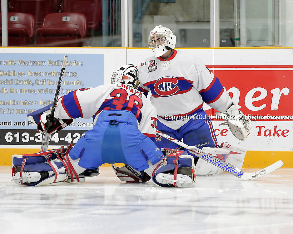TRENTON, ON - Oct 9, 2015 : Ontario Junior Hockey League game action between Toronto and Trenton,  Daniel Lopapa #30 and Brendan Bonello #1 of the Toronto Jr Canadiens during the pre-game warmup<br /> (Photo by Amy Deroche / OJHL Images)
