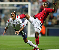 Photo: Rich Eaton.<br /> <br /> England U21 v Germany U21. UEFA European Championship Play-Off 1st Leg. 06/10/2006. Theo Walcott of England left is fouled by Germanys Kevin-Prince Boeteng