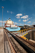 Cargo ship lowered from level at Miraflores Locks. Panama Canal, Panama City, Panama, Central America.