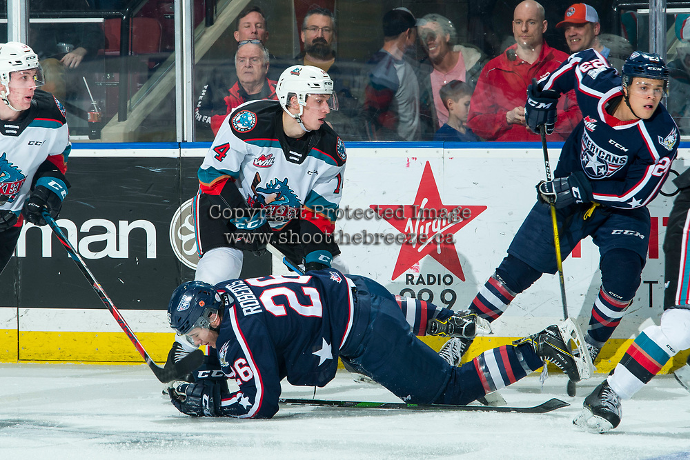KELOWNA, BC - FEBRUARY 12: Devin Steffler #4 of the Kelowna Rockets checks Landon Roberts #26 of the Tri-City Americans during second period at Prospera Place on February 8, 2020 in Kelowna, Canada. (Photo by Marissa Baecker/Shoot the Breeze)