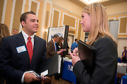 19082Fall Career Fair in Baker Center 10/08/08..Lindsey Prebles, corporate recruiter, Reynolds and Reynolds talks to Matthew Venturella