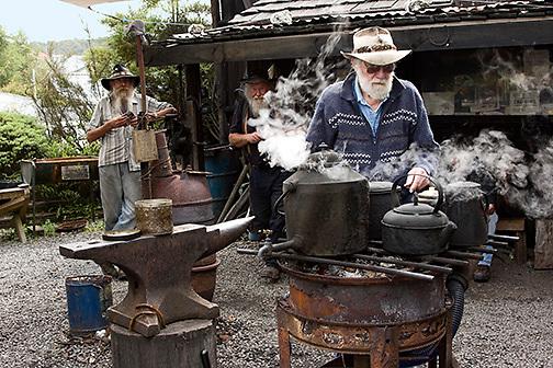 Bearded Miners Hut, elderly men preparing tea outdoors, Reefton, New Zealand