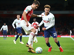 December 19, 2018 - London, England, United Kingdom - London, UK, 19 December, 2018.Sokratis Papastathopoulos of Arsenal under pressure from Tottenham Hotspur's Dele Alli in Action .during Carabao Cup Quarter - Final between Arsenal and Tottenham Hotspur  at Emirates stadium , London, England on 19 Dec 2018. (Credit Image: © Action Foto Sport/NurPhoto via ZUMA Press)