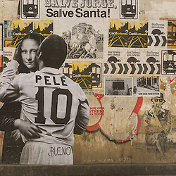 Wallpainting with former football star Pele hugging the Mona Lisa, Rio de Janeiro, Brazil.