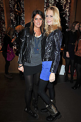 Left to right, VIOLET VON WESTENHOLZ and POPPY DELEVINGNE at a party to celebrate the launch of the new Mulberry leather case for Apple's iPhone held at the Mulberry store, Bond Street, London on 5th November 2009.