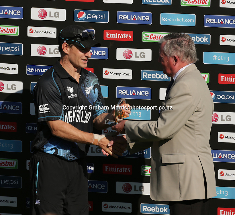 Nathan McCullum receives his man of the match award from former ICC President David Morgan (right) after the ICC Champions Trophy ODI between New Zealand and Sri Lanka in Cardiff, Wales. Photo: Graham Morris/photosport.co.nz 09/06/13