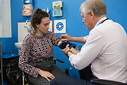 A patient seeing a doctor at a Doctors of The World drop in clinic in Bethnal Green, London, UK.<br /> <br /> The volunteer doctors, nurses and support workers offer primary care and health care advice to excluded people including asylum seekers and undocumented migrants.