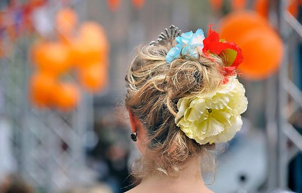 Nederland, Nijmegen, 30-4-2012Koninginnedag. Vrouw met oranje bloem in het haar.Foto: Flip Franssen/Hollandse Hoogte