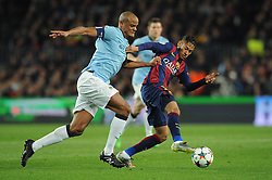 Manchester City's Vincent Kompany jostles for the ball with  Barcelona's Neymar - Photo mandatory by-line: Dougie Allward/JMP - Mobile: 07966 386802 - 18/03/2015 - SPORT - Football - Barcelona - Nou Camp - Barcelona v Manchester City - UEFA Champions League - Round 16 - Second Leg