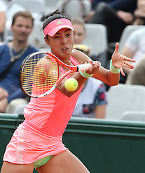 PARIS, FRANCE - Tuesday, May 26, 2016: Wang Qiang of China competes during the women's singles first round match against Francesca Schiavone of Italy at 2015 French Open tennis tournament at Roland Garros, in Paris, France on May 26, 2015. (Xinhua)