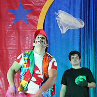 David the Clown juggles pieces of cloth.